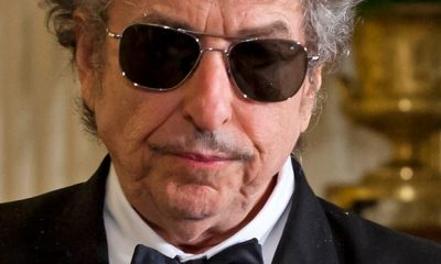 Portrait of Bob Dylan in dinner suit and shades