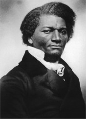 Black and white photo of a handsome black man in a white cravat and black jacket
