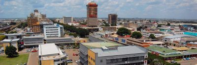 An aerial view of Lusaka taken from the north looking down the main tree-lined road known as Cairo Road.