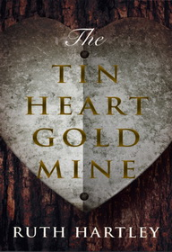 The book cover of The Tin Heart Gold Mine by Ruth Hartley is a photo of a rusty white metal heart nailed to a brown tree bole, with the book title in gold centred over the heart.