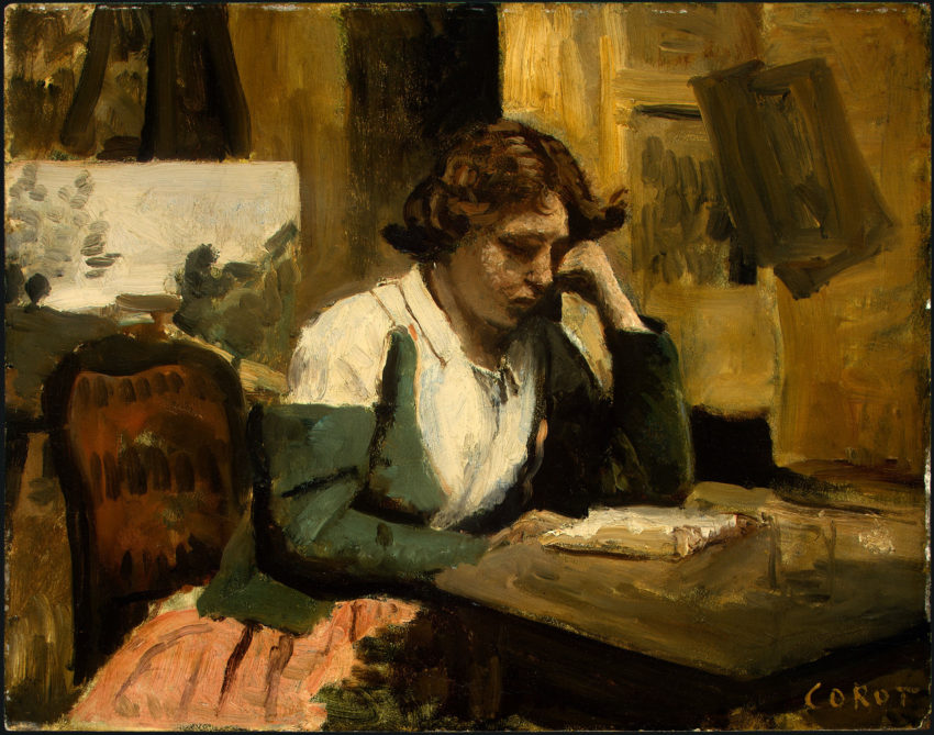 A young girl in a green and white bodice with a long skirt sits at ther desk reading with her head propped on her left hand
