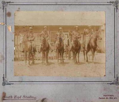 A very faded sepia photograph shows 5 mounted soldiers of the Imperial Yeomanry in Pretoria during the Anglo-Boer war