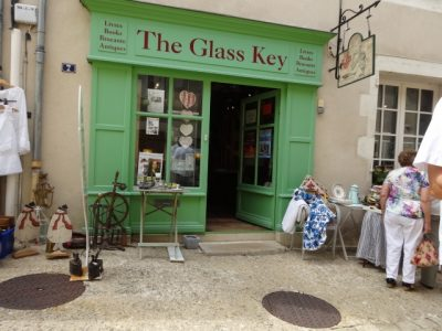 The green front of the Glass Key bookshop with its doors open