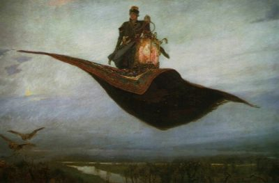 A prince in a fur hat and coat stands on his magic carpet next to a glowing lantern. It is twilight as he flies over a river so high that there are birds flying below him