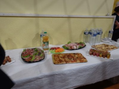 Trays of charcuterie, savoury tarts and small cups of tasty ratatouiille and dips are arranged on a table