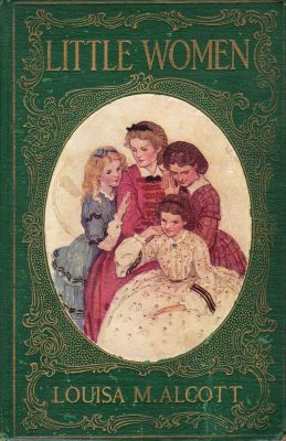 An old-fashioned book cover with embossed gold lettering and decoration around a cameo of the 4 girls, Meg, Jo, Amy and Beth in Victorian clothes