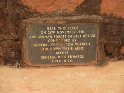 "The slightly battered metal plaque annouces that ""Near this place on 25th November 1918 The German Forces in East Africa commanded by General Von Lettoew Vorbeck laid down their arms before General W F S Edwards CMG DSO"