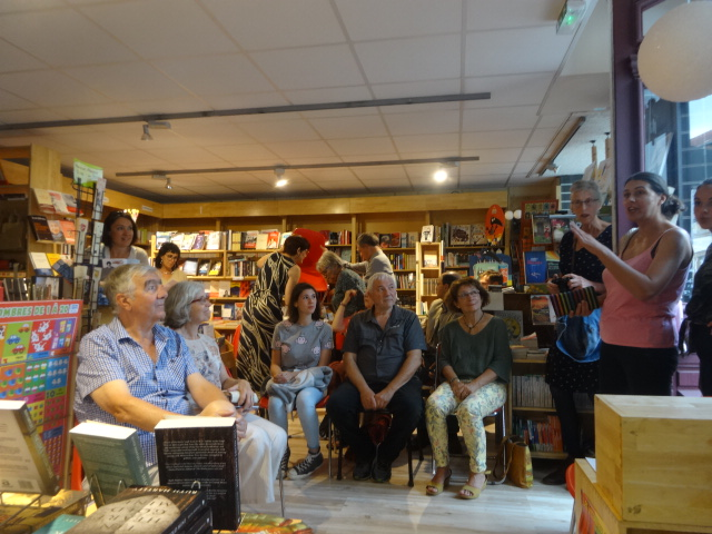 An audience member asks a question at Ruth Hartley's book launch where she explained the lifetime experiences that lie behind the three books launched on 27 Sept 2019