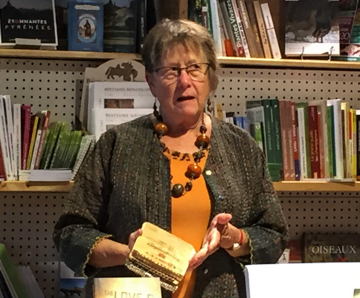 Ruth Hartley holding the original Spiral-Bound Notebooks which contain the poems written a lifetime ago that provided the inspiration for her three 2019 books.