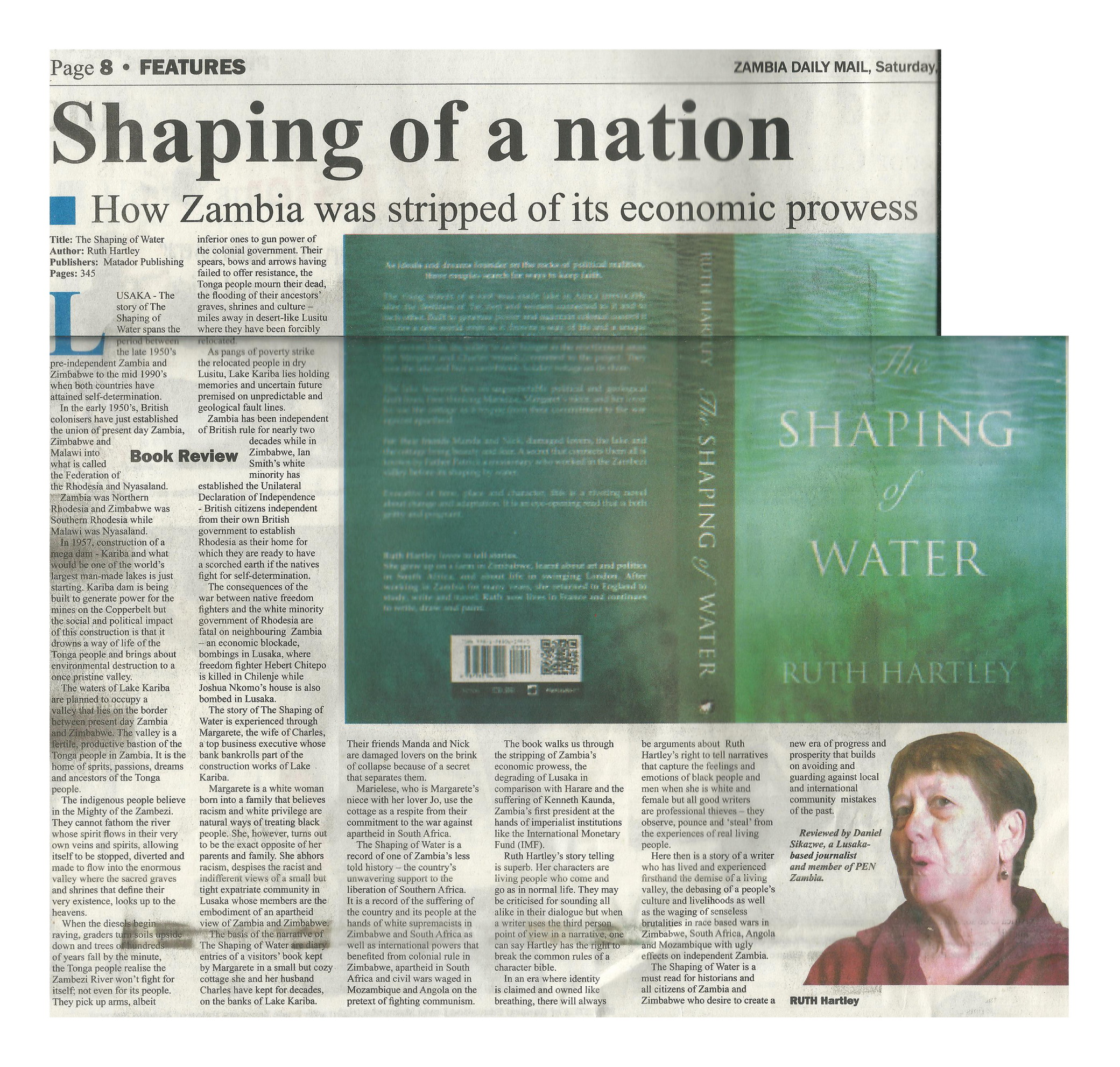 Scan of the review by Daniel Sikazwe in the Zambia Daily Mail of the The Shaping Of Water including a picture of the book cover with white text on an aqua background.
